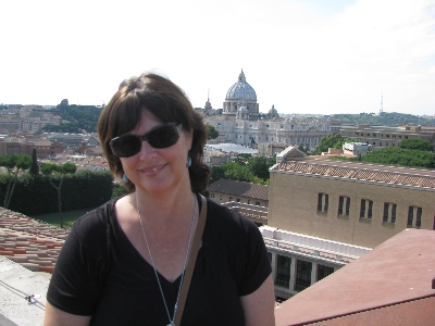 Judi at the Pontifical North American College with St. Peter's in the distance